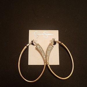 Oval shaped gold with diamonds hoops.